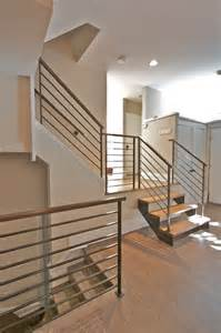 steel railings with walnut handrails modern staircase chicago by iron amp wire llc