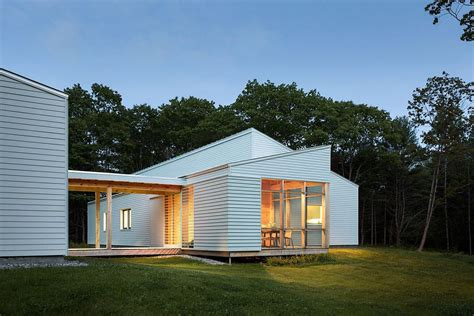 covered garage solar powered zero energy home surrounded by a pine forest