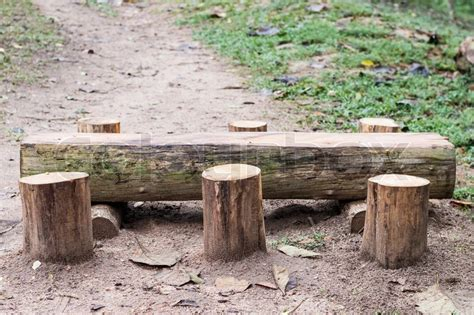 bench made out of tree trunk wooden bench and table made of tree trunks stumps stock photo colourbox