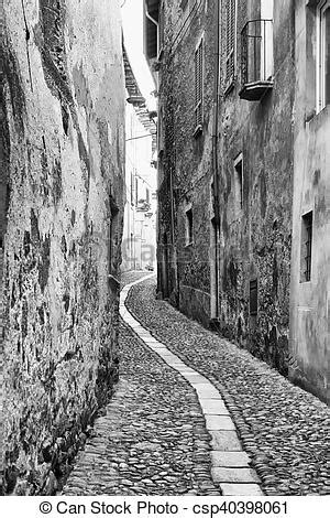 Narrow road, black and white, vertical image.
