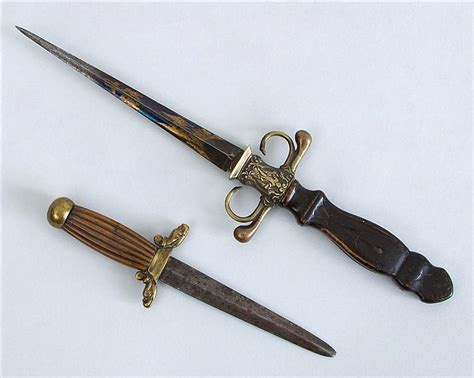 Decorative Daggers by Two Decorative Brass Mounted Wood And Metal Daggers