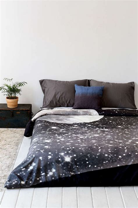 moon and stars comforter under the milky way galaxy and moon phase decor