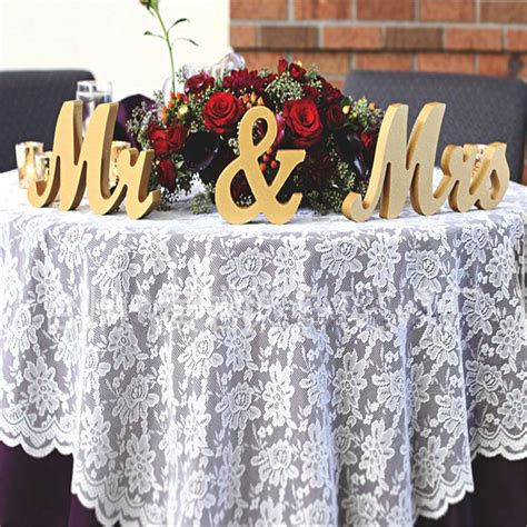 gold wooden   standing letters wedding table