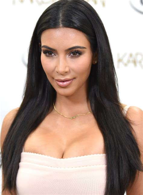 just long enough to tuck behind your ears long pixie middle part hair tucked behind ears 50 best kim kardashian