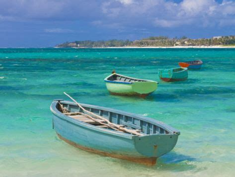small fishing boats in the turquoise sea mauritius - Small Boats For Sale Mauritius