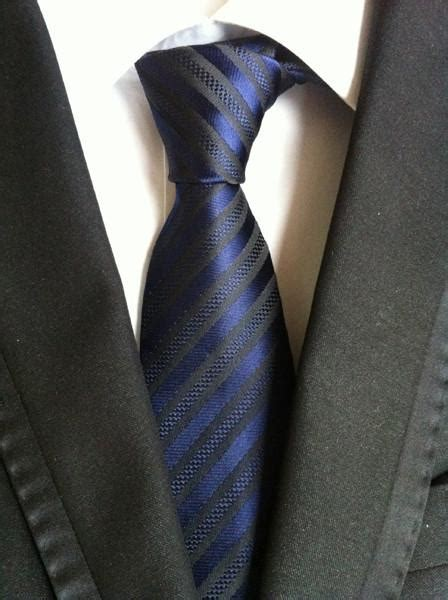 striped tie and checkered shirt beneath an elegant grey classy thin blue line checkered tie thin blue line shop