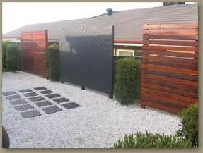 Privacy Screen Ideas For Backyard White Pebble Walkway With Grey Pavers Which Math The Focal Point Privacy Screen