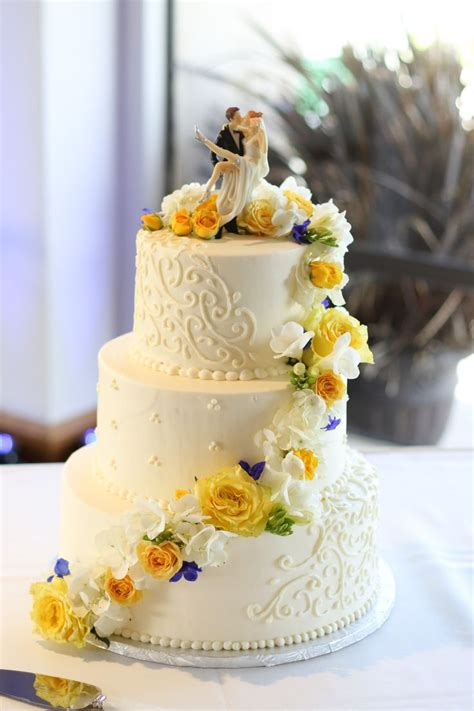 cakeflowers weddingcake yellow blue roses yellow wedding flowers yellow wedding flowers