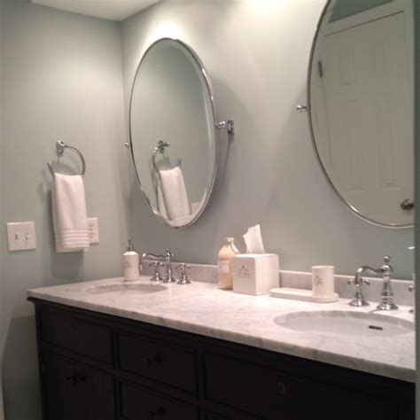 bathrooms with mirrors double vanity faucets oval pivot mirrors and bath