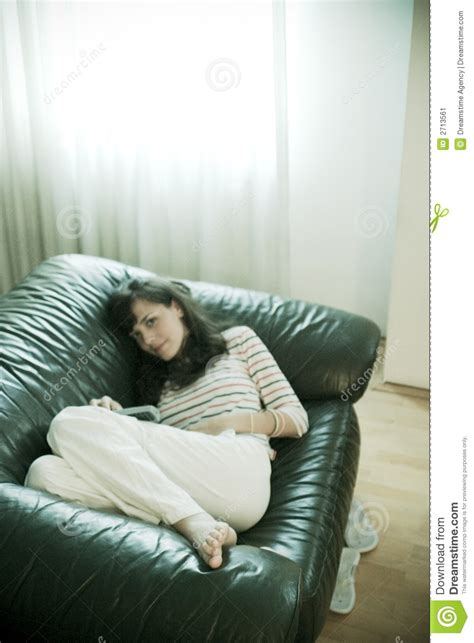 laid on the couch girl laying on couch stock image image 2713561