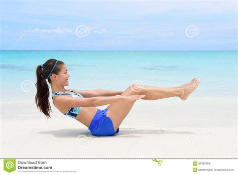 fitness woman    crunch ab toning exercise stock