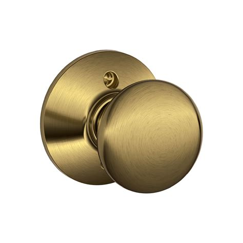 Schlage Plymouth Knob by Shop Schlage F Plymouth Antique Brass Dummy Door Knob At
