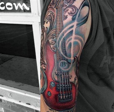 tattoo 3d guitar big 3d like colored bass guitar tattoo on half sleeve area