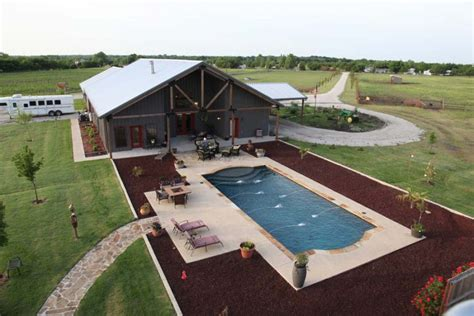 building home a complete metal building home with a pool and a stable