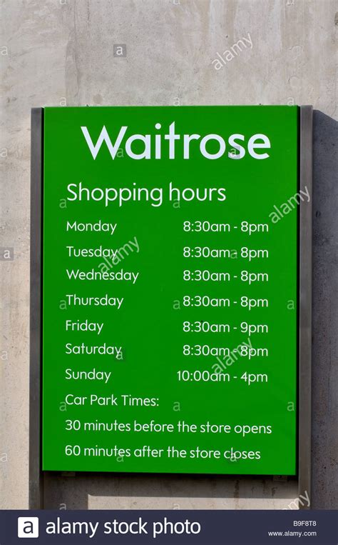 waitrose store opening hours sign uk stock photo royalty