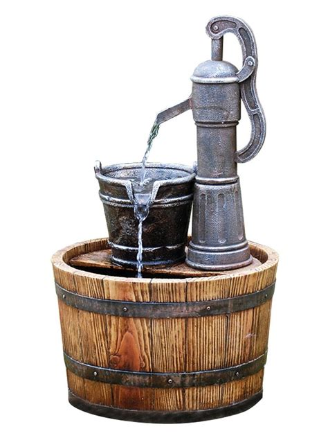 solar powered pump on wooden barrel garden water feature