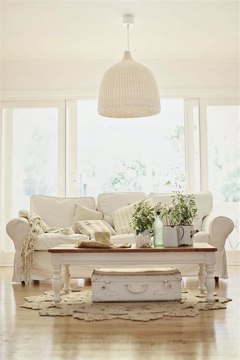 White Table For Living Room by Comfortable White Slipcovered Sofa That Brings
