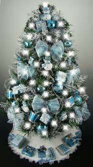 Christmas tree decorations blue silver white decorated mini tabletop