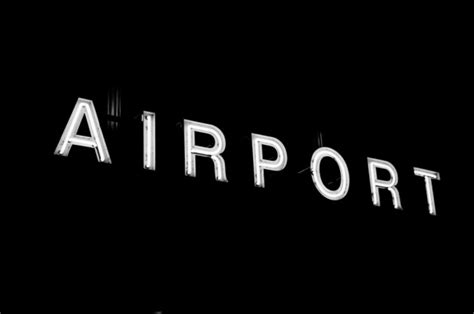 10 year background check airport airport sign in black background photo free