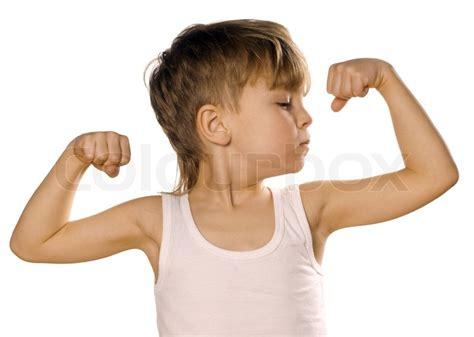 little boy flexing bicep little boy flexing biceps stock photo colourbox