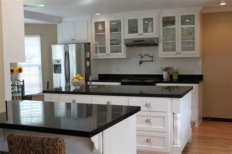 black kitchen cabinets with white countertops white kitchen cabinets with black granite countertops