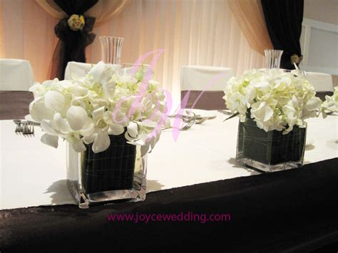 orchid head table centerpieces joyce wedding services