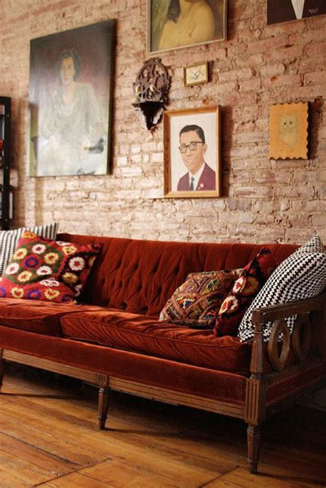 wall color for red couch autumn color palette velvet sofa exposed brick