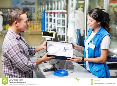 buying a buying clothes in shop stock photography image 21771372