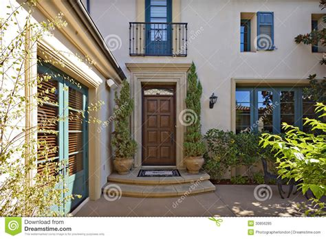 home entrance entrance to a beautiful mediterranean home exterior stock