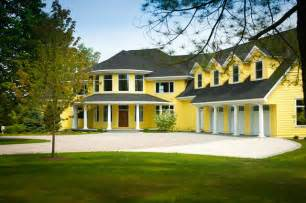 yellow-house-traditional-exterior-by-widing-custom-homes