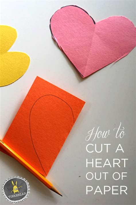 How To Make Hearts Out Of Paper - how to cut a out of paper tinkerlab