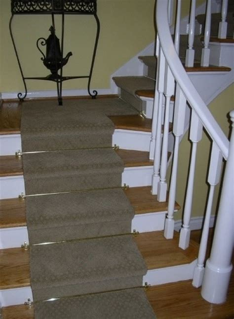 Home Decorating Company staircase renovation wood tread with carpet runner