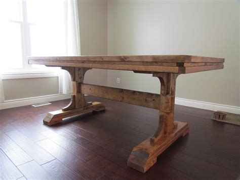 How To Build A Trestle Dining Table Diy Rustic Distressed Farmhouse Table With Pedestal On Brown Hardwood Floor Tiles Beside