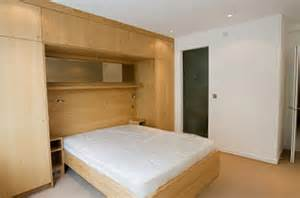 bedroom on bedroom featuring a large built in wardrobe