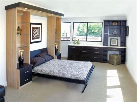 murphy fold bed with cabinetry on either side for