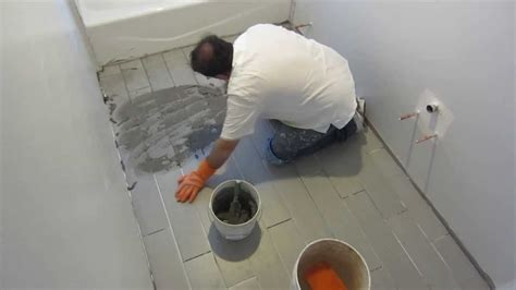 how to put on tiles in bathroom part 8 how to install wood look plank tile on schluter