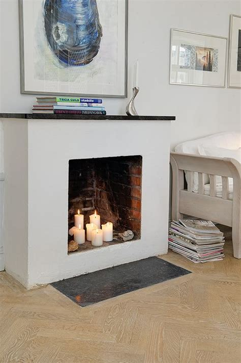 how to decorate empty space next to fireplace 21 best images about how to fill a fireplace on pinterest