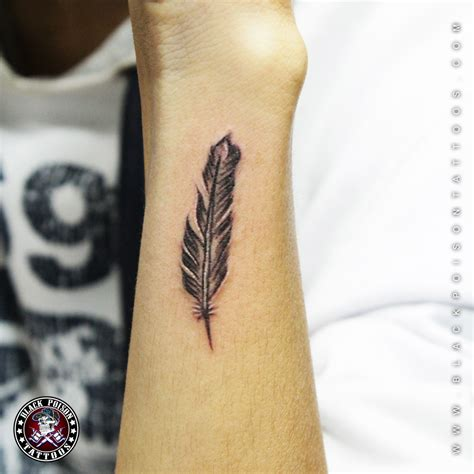 small forearm tattoo designs feather tattoos and its designs ideas images and meanings
