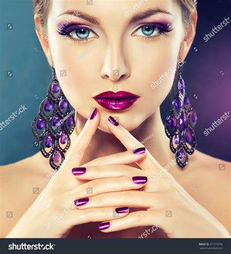 beautiful fashion model in jewelery and lila manicure beautiful girl model fashion makeup purple stock photo