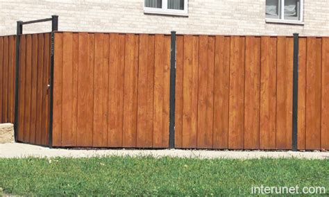 wood and metal fence metal and wood fence www imgkid the image kid has it