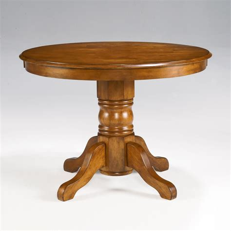 pedestal dining room table home styles pedestal dining table dining tables at