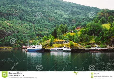 small boat norway cruise cruise ship and small boat on a pier norway travel stock