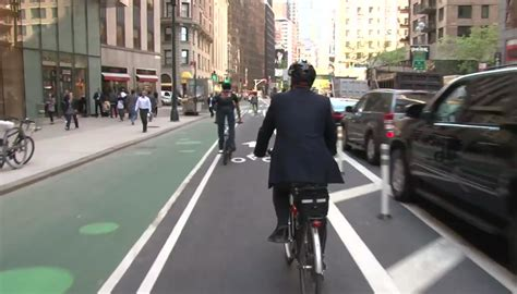 nacto streetsblog new york city green lane project spreads the word about nacto s bikeway