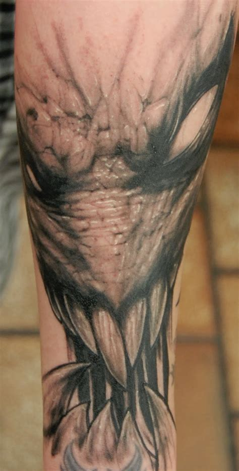 biomachanical tattoos black and gray dark bio