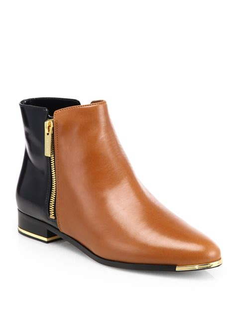 black or brown boots michael kors cindra ankle boots in brown brown black lyst