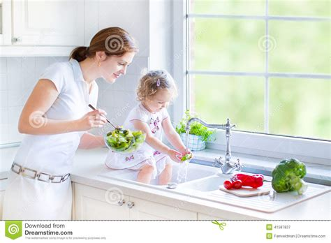 Washing Baby In Kitchen Sink Toddler Washing Vegetables In Kitchen Sink