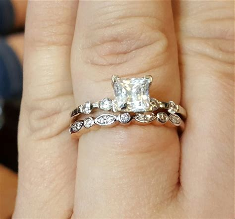 new wedding ring and engagement ring order on finger