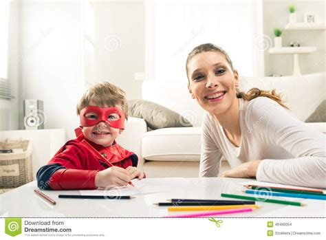 mom and son have in livingroom drawing together stock photo image 46490054