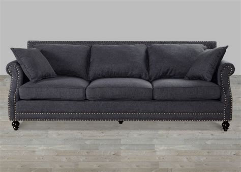 grey linen sofa with nailheads
