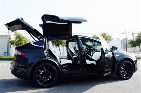 How To Open Tesla Doors Tesla Quietly Settles With Model X Owner Who Filed For